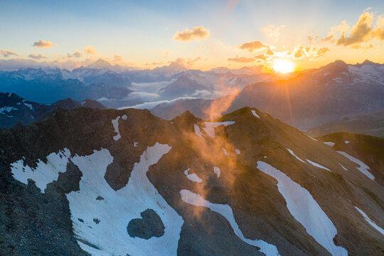 Last rays of sunset light the rocky mountain peaks, Furka Pass, Canton Uri, Switzerland