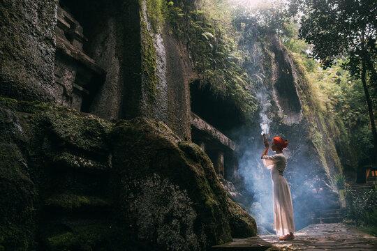 Asian Woman Prays In Nature