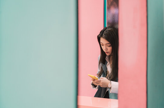 fashion business Asian woman using a cell phone