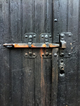 lock on old black door