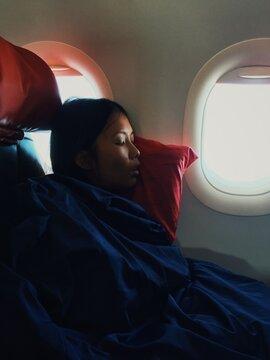 Woman sleeping in a plane