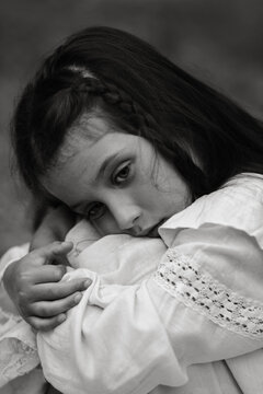 A black and white close up portrait of a dark haired girl