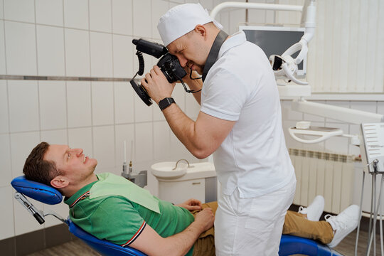 a dentist in a dental clinic tells the client how to treat and care for their teeth