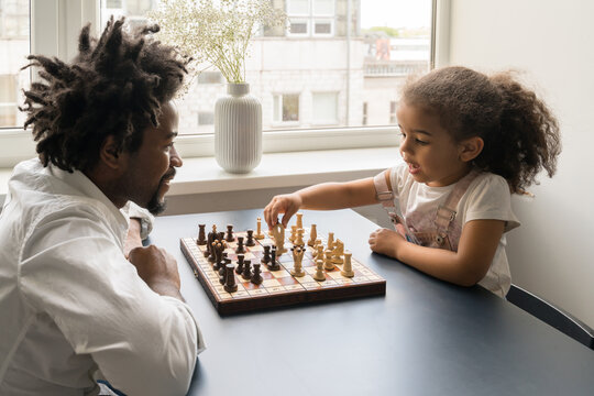 Father And Daughter playing Table Game