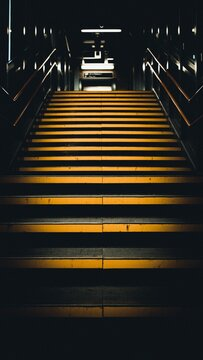Moody yellow stairs at a train station in London