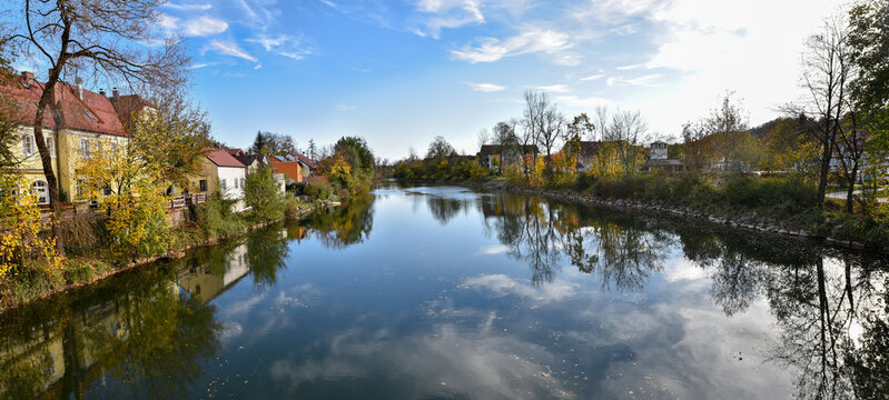 Loisach river at Wolfratshausen village, in autumnal season. bavarian landscape