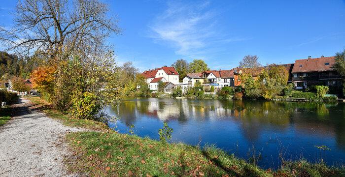 walkway along Loisach riverside, Wolfratshausen spa town, colorful autumn scenery