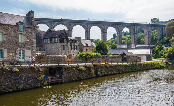 Dinan, France - August 26, 2019: Port of Dinan and Viaduct of Lanvallay over the Rance river in French Brittany