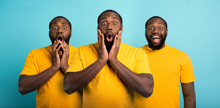 Black man with wondered, surprised and happy expression on cyan background