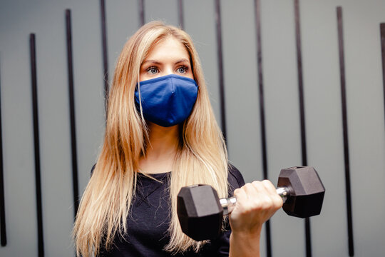 woman in protective masks trains in gym