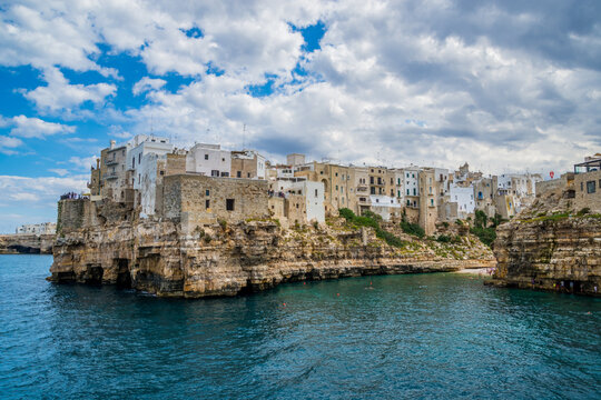 Cliffs of Polignano a Mare on a warm and sunny day, Puglia, Italy