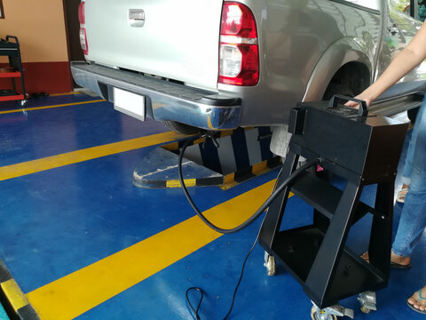pick up one ton truck emission testing air pollution meter in garage