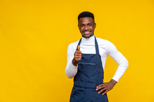 african male chef gives a thumbs up