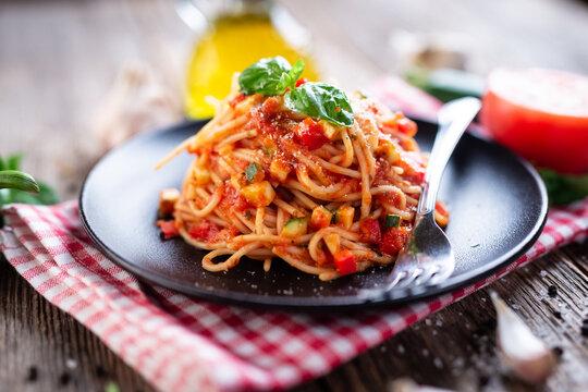 Spaghetti with eggplant, zucchini, paprika and tomato sauce
