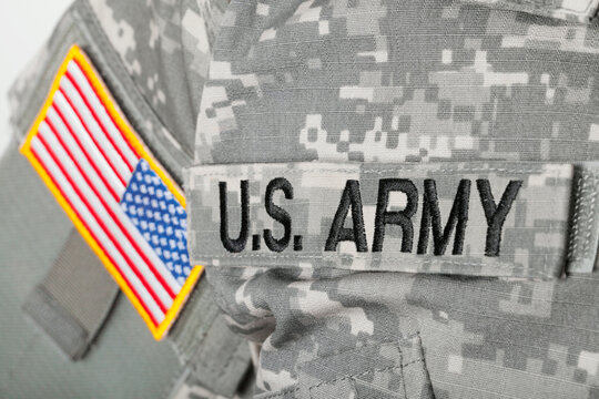WARSAW, POLAND - JANUARY 26, 2015: Close up studio shot of U.S. ARMY and USA flag patches on solders uniform