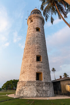 The old lighthouse of white stone located on the island