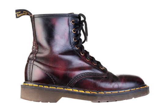 KIEV, UKRAINE - NOVEMBER 14, 2020: Dr Martens 1460 burgundy leather boots. trendy punk style historic british leather boots. Dr Martens Air War with adhesive soles. built on conscience.