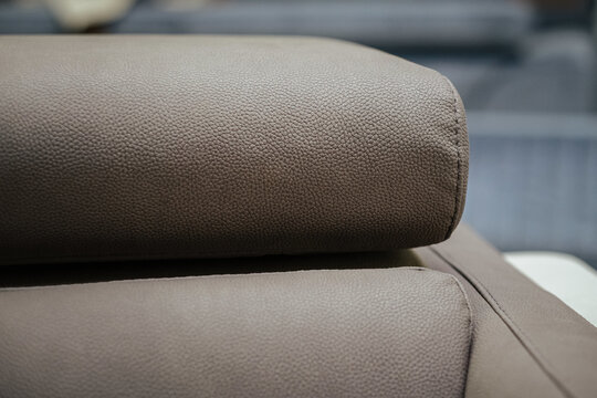 Closeup of the leather detail of a gray sofa