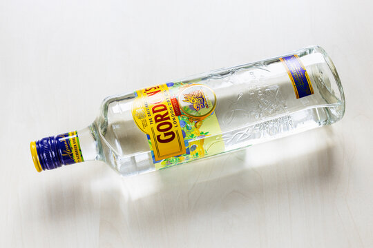 MOSCOW, RUSSIA - NOVEMBER 4, 2020: top view of lying bottle of Gordon's London Dry Gin on light brown board. Gordon's is brand of London dry gin first produced in 1769.