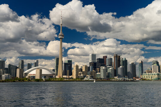 Downtown Toronto cityscape on Lake Ontario with clouds in the evening Toronto, Canada - August 3, 2013