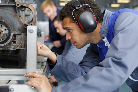 close up mechanical man using tool