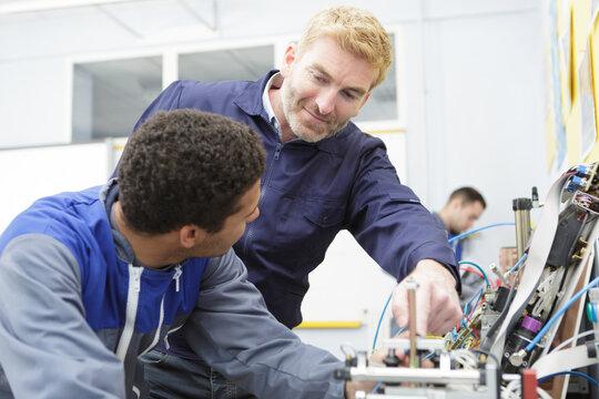 technicians work in industry environment