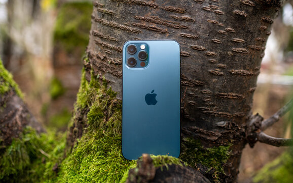 Paris, France - Nov 11, 2020: Rear view of the new iPhone 12 Pro Max 5G smartphone model by Apple Computers close-up of Pacific Blue mobile phone device featuring triple-camera and lidar sensor