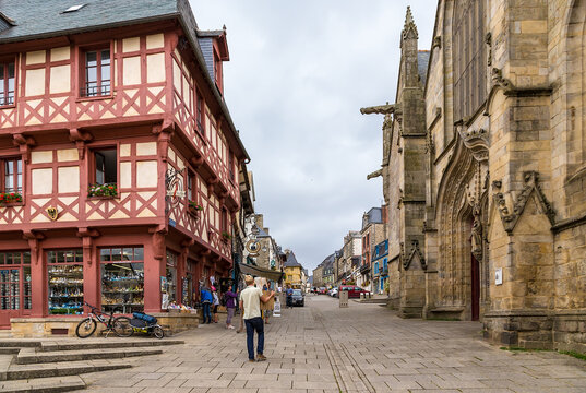 Josselin, France. Facade of the basilica on rue Olivier de Clisson