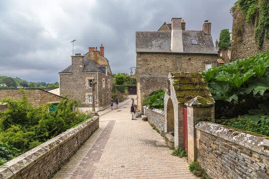 Josselin, France. Old stone buildings in cloudy weather