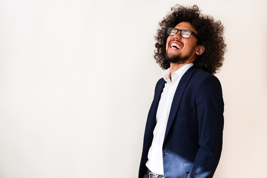 Latin American model in a suit, happy expression, laughing, white background