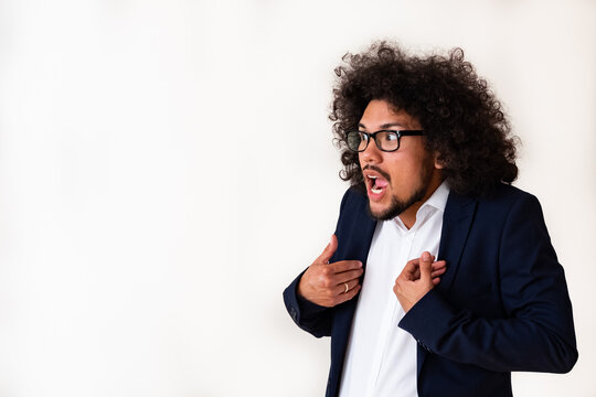 Latin American model in a suit, shocked expression, white background