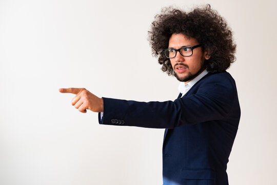 Latin American model in a suit, angry expression, white background