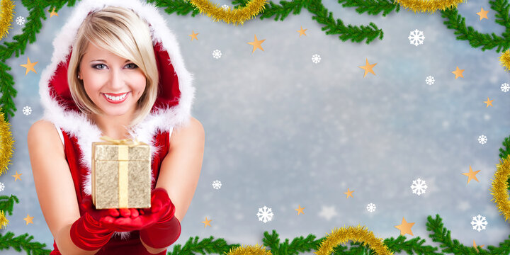 woman dressed as Miss Santa holding a golden present in front of christmas background