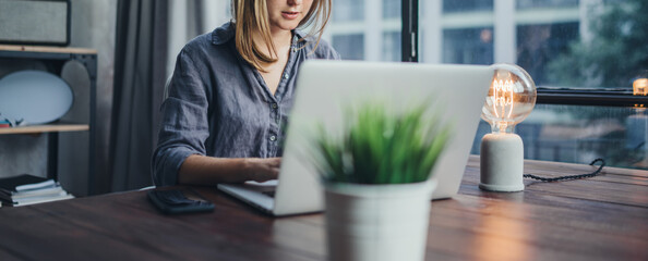 Woman working on laptop. Freelancer at remote work. Female student learning on-line via computer....