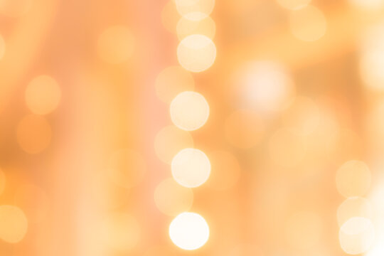 Abstract yellow soft light with circlel blurred bokeh christmas background.