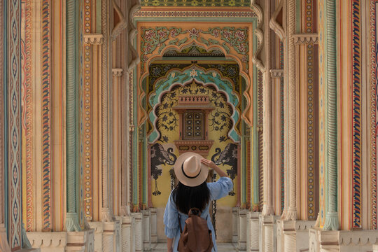 "Woman tourist is traveling and sightseeing at Patrika Gate in the Jawahar Circle Gardens in the ""Pink City"" , Jaipur, Rajasthan, India. Description1"