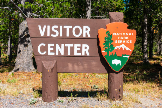 Visitor Center sign with National Park Service arrowhead insignia - Yellowstone National Park, Wyoming, USA - 2020