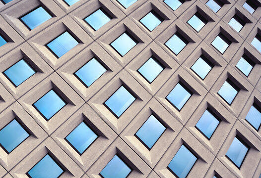 Blue Windows Architecture Symmetric Pattern on Modern Building Exterior