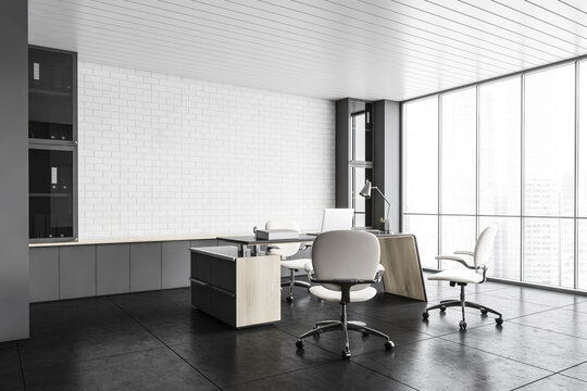 White office lobby room with laptop, chairs and table, brick wall on background