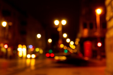 Cozy evening in the festive city. Blurred image of street with lights for Christmas and New Year celebration time or calm evening. Shining avenue at midnight. Abstract holiday  background. Fotomurales