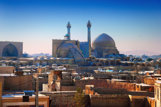 Isfahan, Iran (Persia), Middle East. Awesome city view, medieval buildings, ancient Jameh (Jame, Masjid) Mosque and traditional orient houses at the background of morning sky at sunrise time
