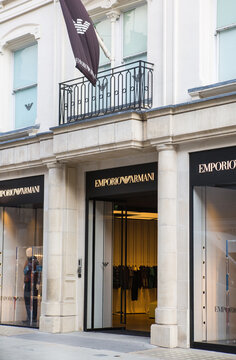 London, UK - August 13, 2019: Logo of the Emporio Armany brand Fashion house in Old Bond Street, major shopping street in the West End of London for luxury designer brands and jewels