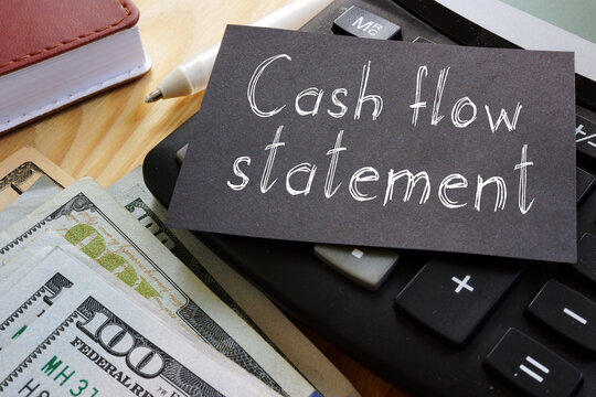 Cash flow statement is shown on the business photo using the text