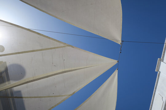 white sun screens against a bright blue sky
