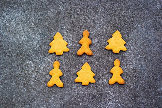 Homemade Christmas cookies or gingerbread coo kies of various shapes on a dark concrete background. Christmas cookies. Merry Christmas concept. Top view