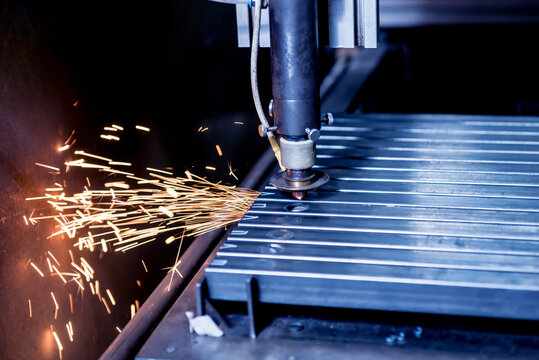 The laser cutting machine cutting the holes on pipes