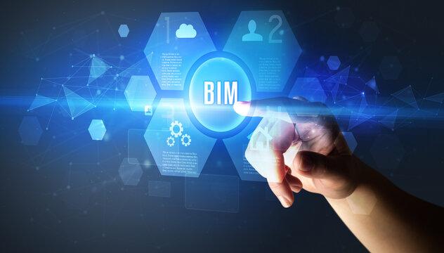 Hand touching BIM inscription, new technology concept