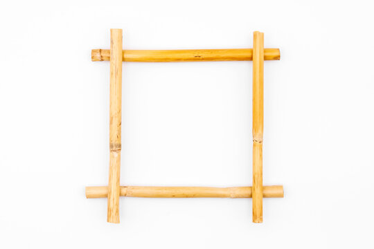 Bamboo frame on white studio background