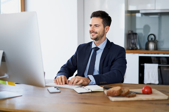 Businessman working on computer from home
