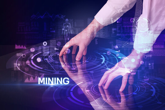 Businessman touching huge display with MINING inscription, modern technology concept